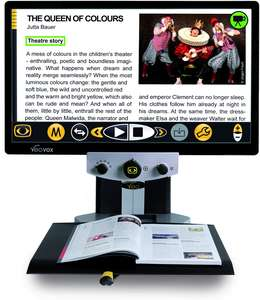 "VEO Vox desktop magnifier with speech displaying magazine page on the 24"" screen"