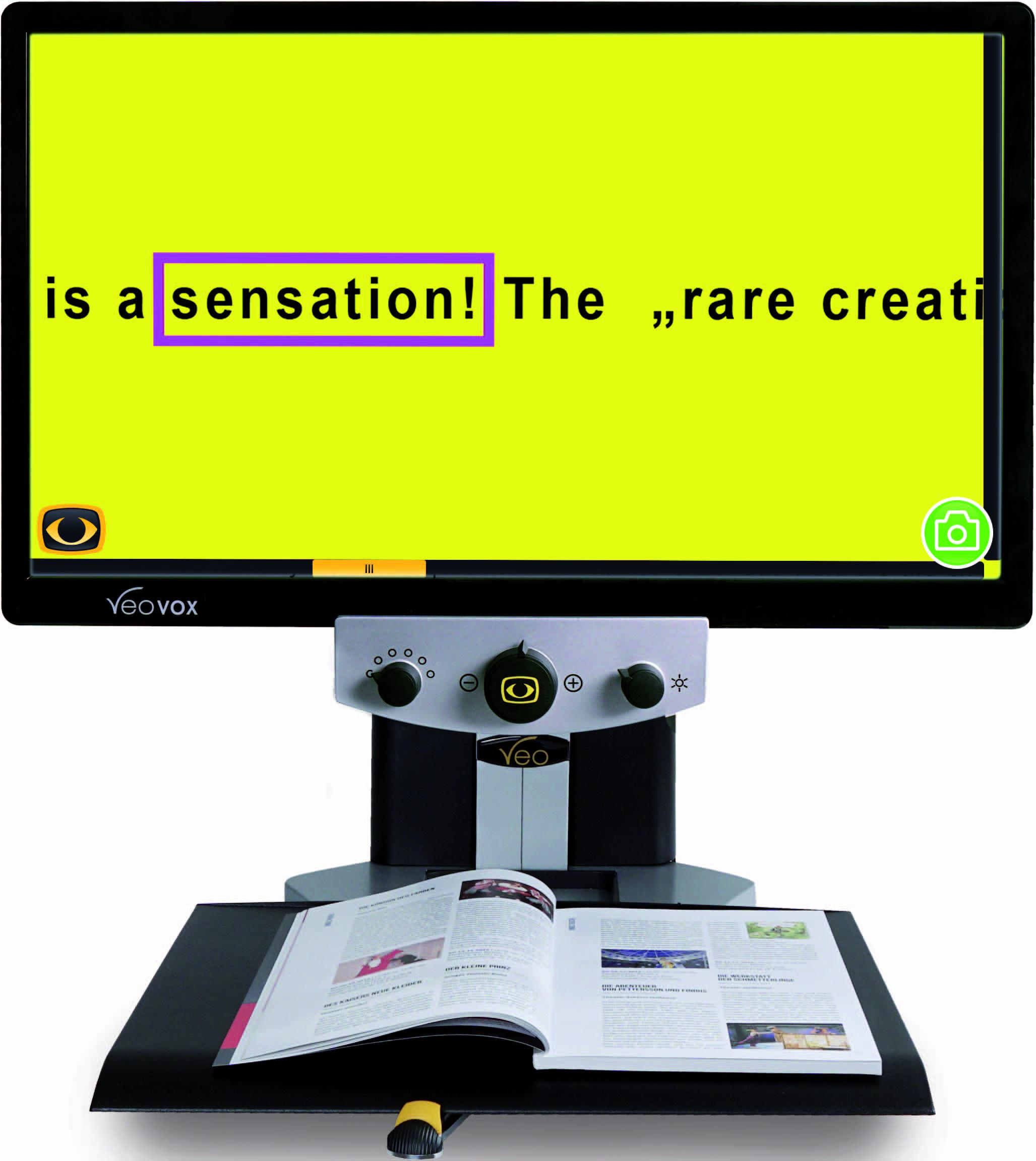 "VEO Vox desktop video magnifier showing black text on a yellow background on its 24""screen"