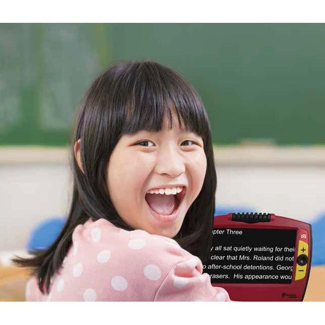 A young girl Smiling using her Ruby 7 HD