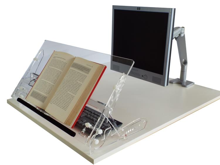 Go Flex Document Holder in its highest position on a desk with an open book sat on the doucument holder, aslo on the desk is a monitor and keyboard