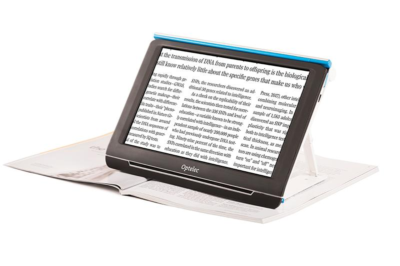 Compact 10 HD Speech sat ontop of a magazine magnifiying the text on its screen