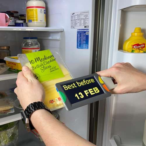 Eye-D v2 magnifying a best before date on a packet of sliced cheese, text shown in enchanced colours; yellow on black