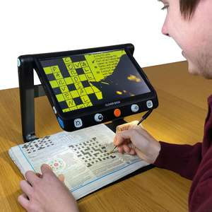 Clover Book magnifying a crossword with the screen showing an enhanced colour mode; black on yellow