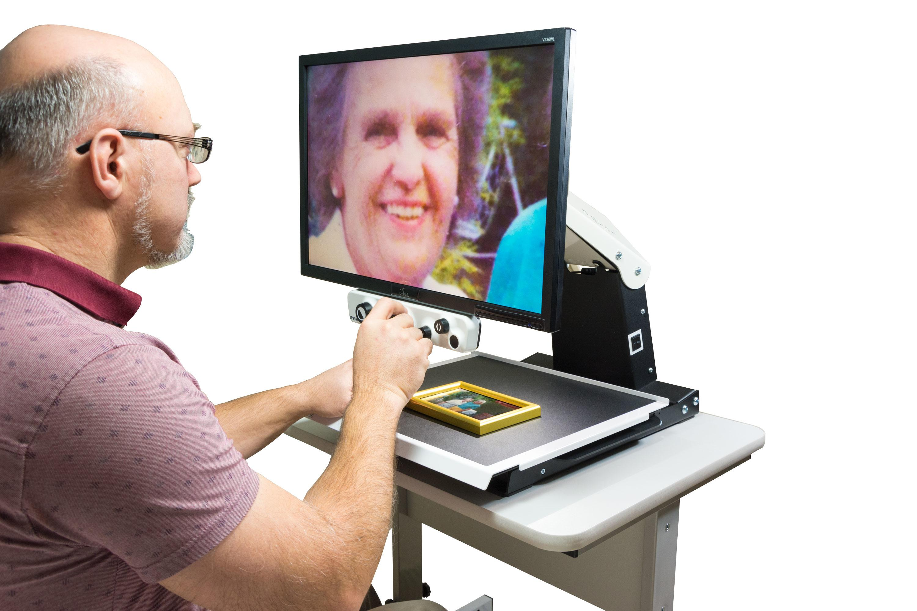 A man using his i-See HD to view a picture of his grandmother