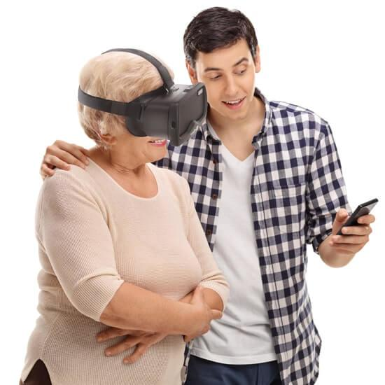 Acesight grandson showing grandmother an image on his mobile phone whilst she's wearing Acesight VR