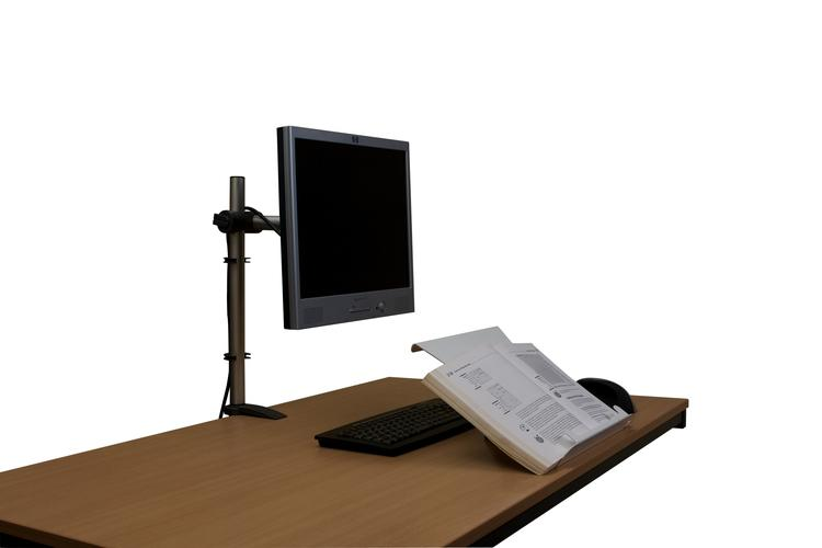 U Turn Document Holder in the book holding position on a desk pulled over a keyboard, there is also a monitor and mouse on the desk