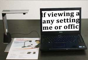 La Voice camera arm with a leaflet underneath, the text is shown on a laptop screen next to it