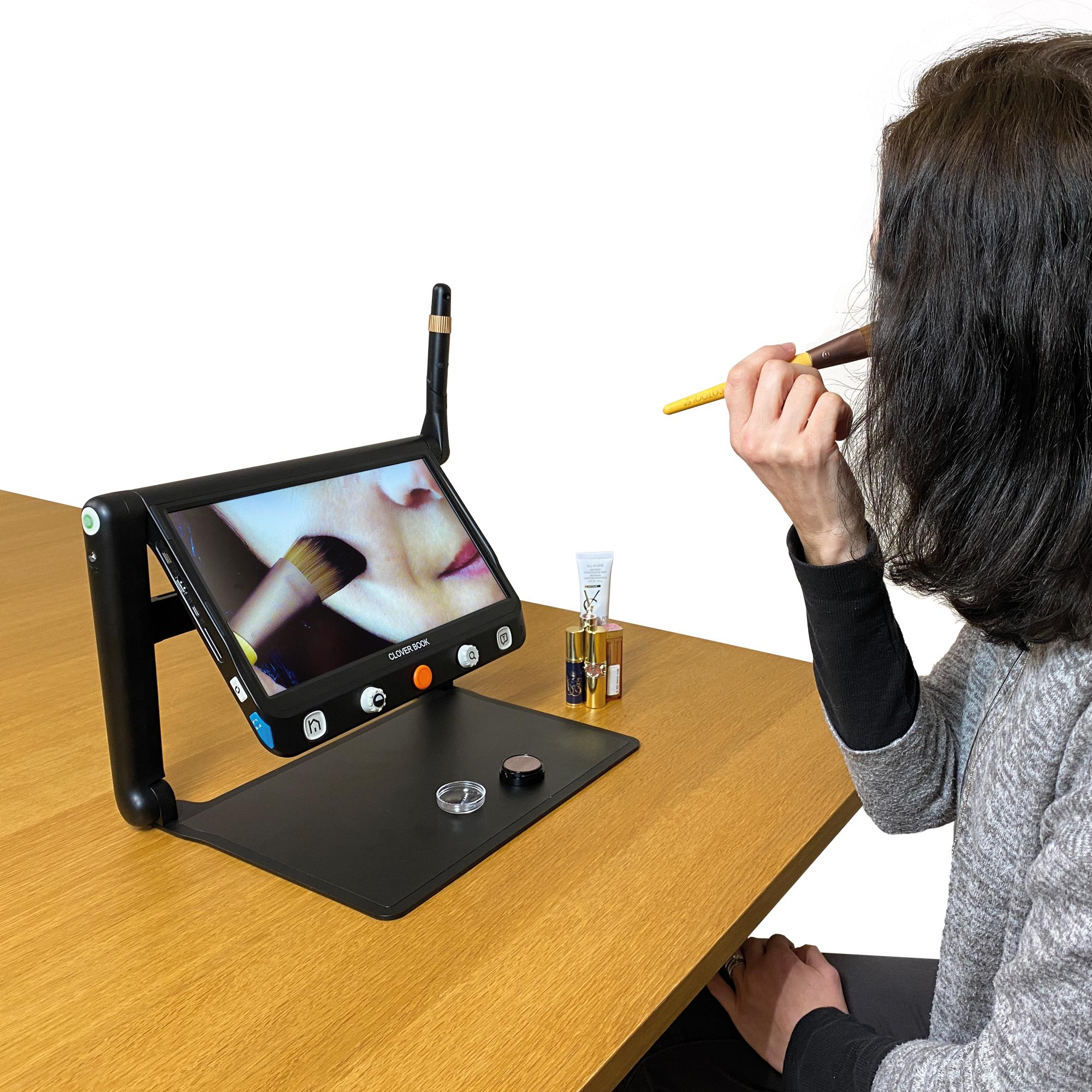 Clover Book with distance camera being used by a lady for applying makeup