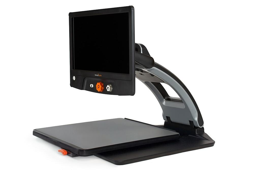 Side view of the Reveal 16 Full HD digital magnifier with XY table