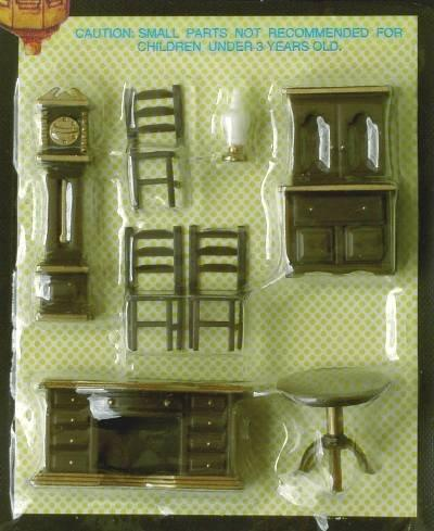 Set of quarter scale brown plastic furniture suitable for the dining room.