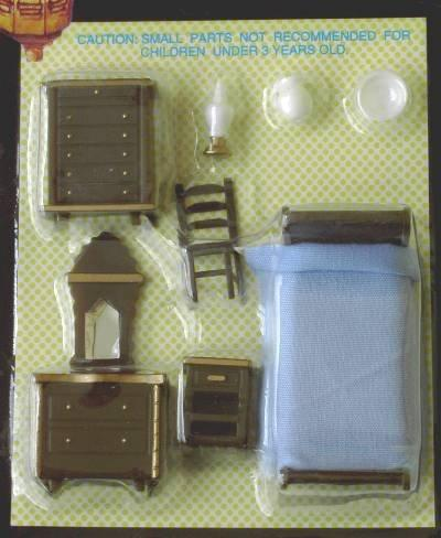 Set of Quarter scale brown plastic furniture for the bedroom