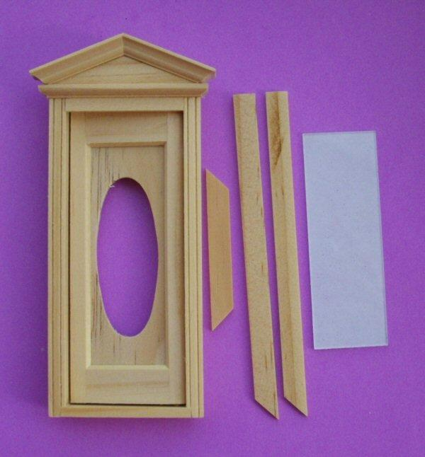 1/24th scale dolls house Victorian style wooden door with oval window.