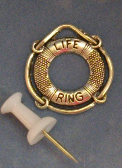 Miniature metal life ring suitable as a decorative item in 1/48th or 1/24th scale nautical or seaside themed scene.