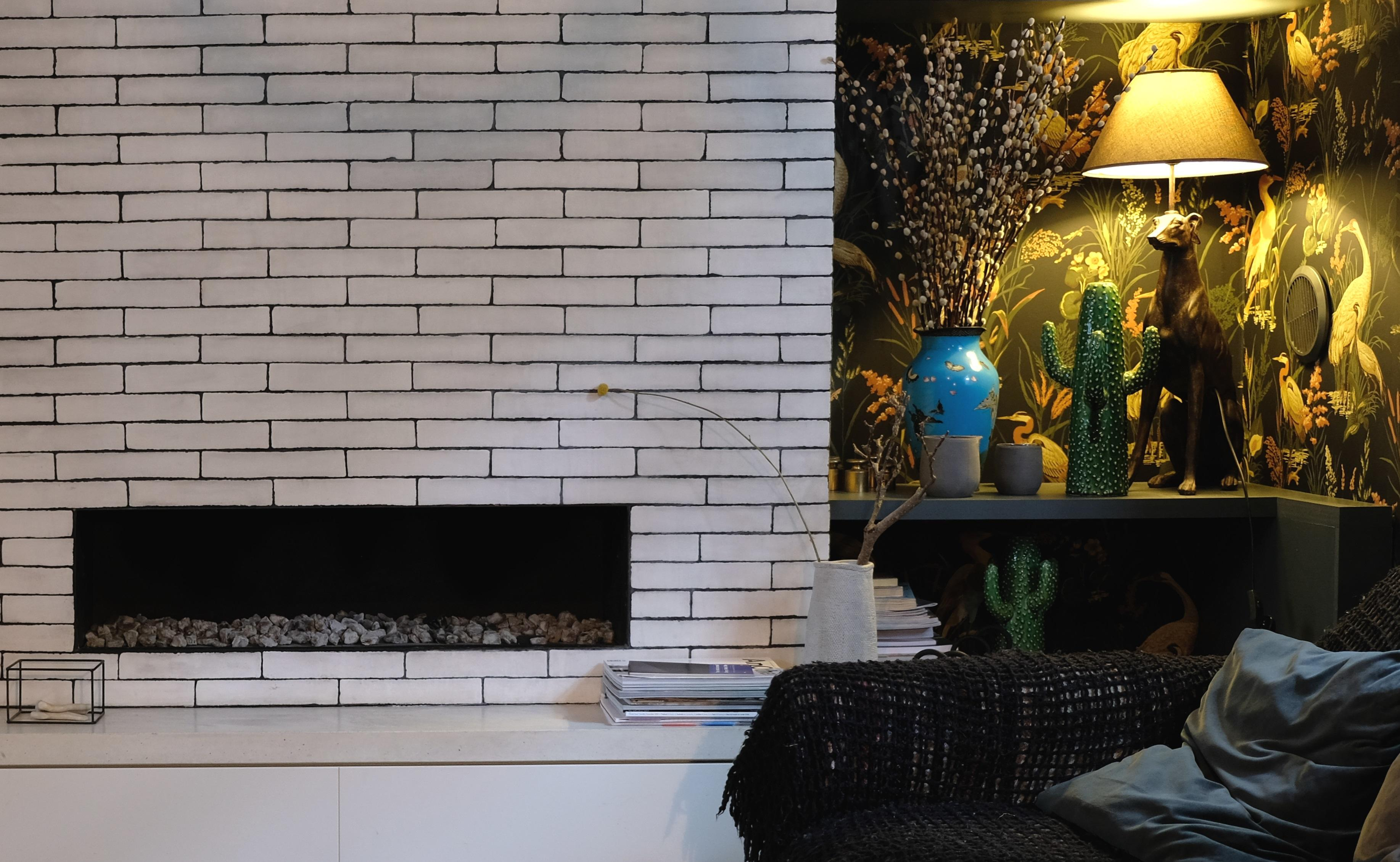 Stunning dark and moody snug with brick fireplace in De Beauvoir Townhouse for Living Etc.