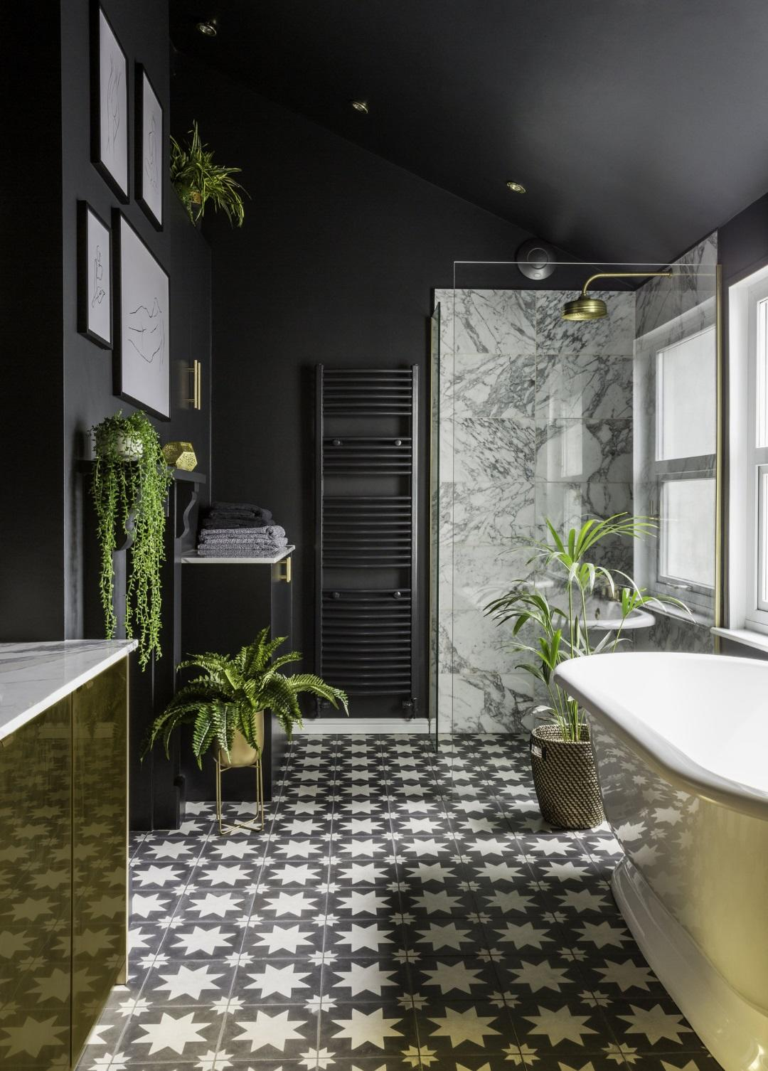Stunning dark bathroom with metallic details by Gold Is A Neutral