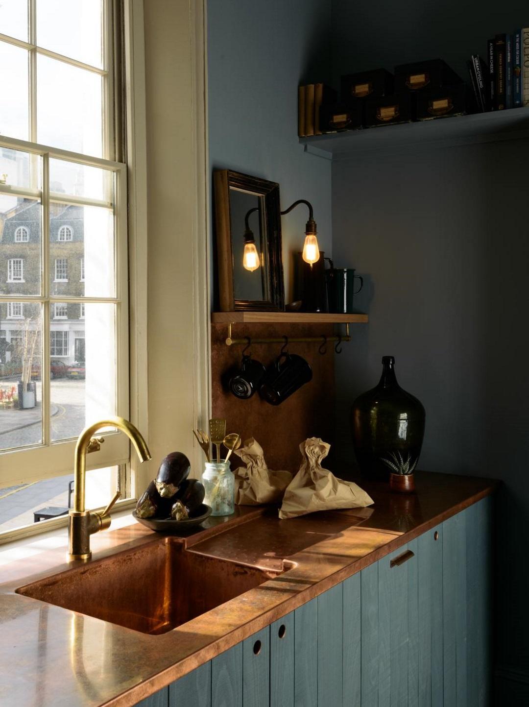 Dark deVOL kitchen with copper accents