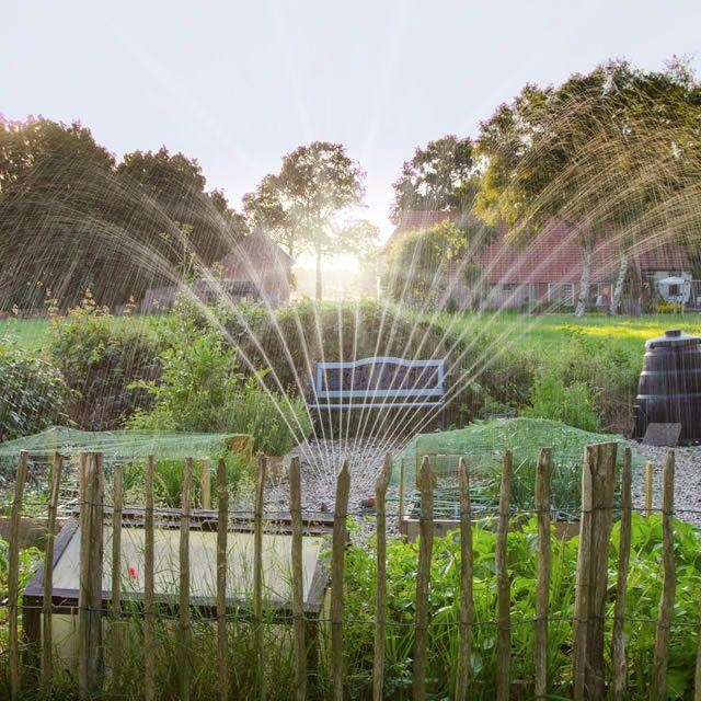 Pop Up Sprinkler System In Garden