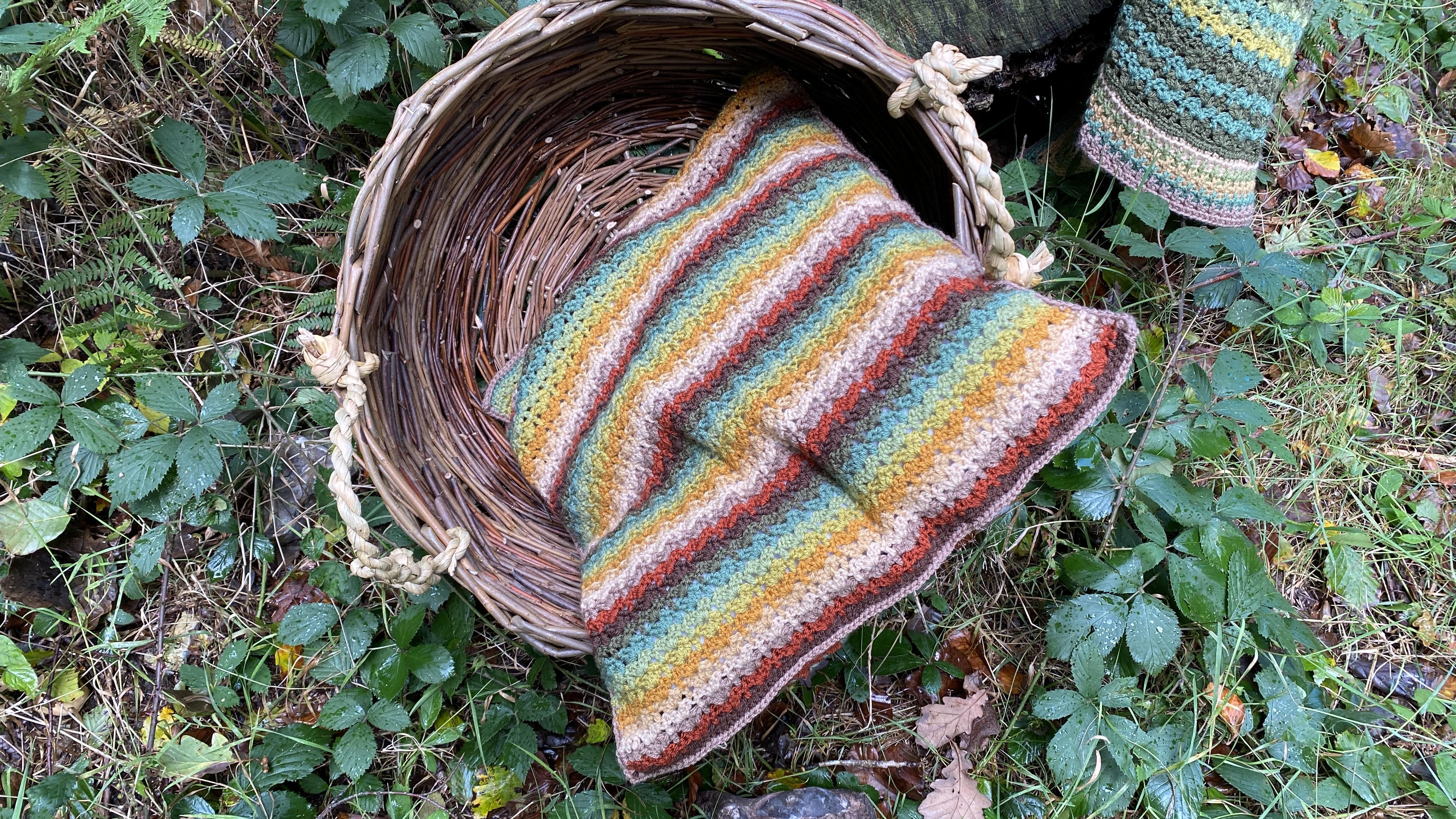 Autumn Walk cushion cover in basket in the woods