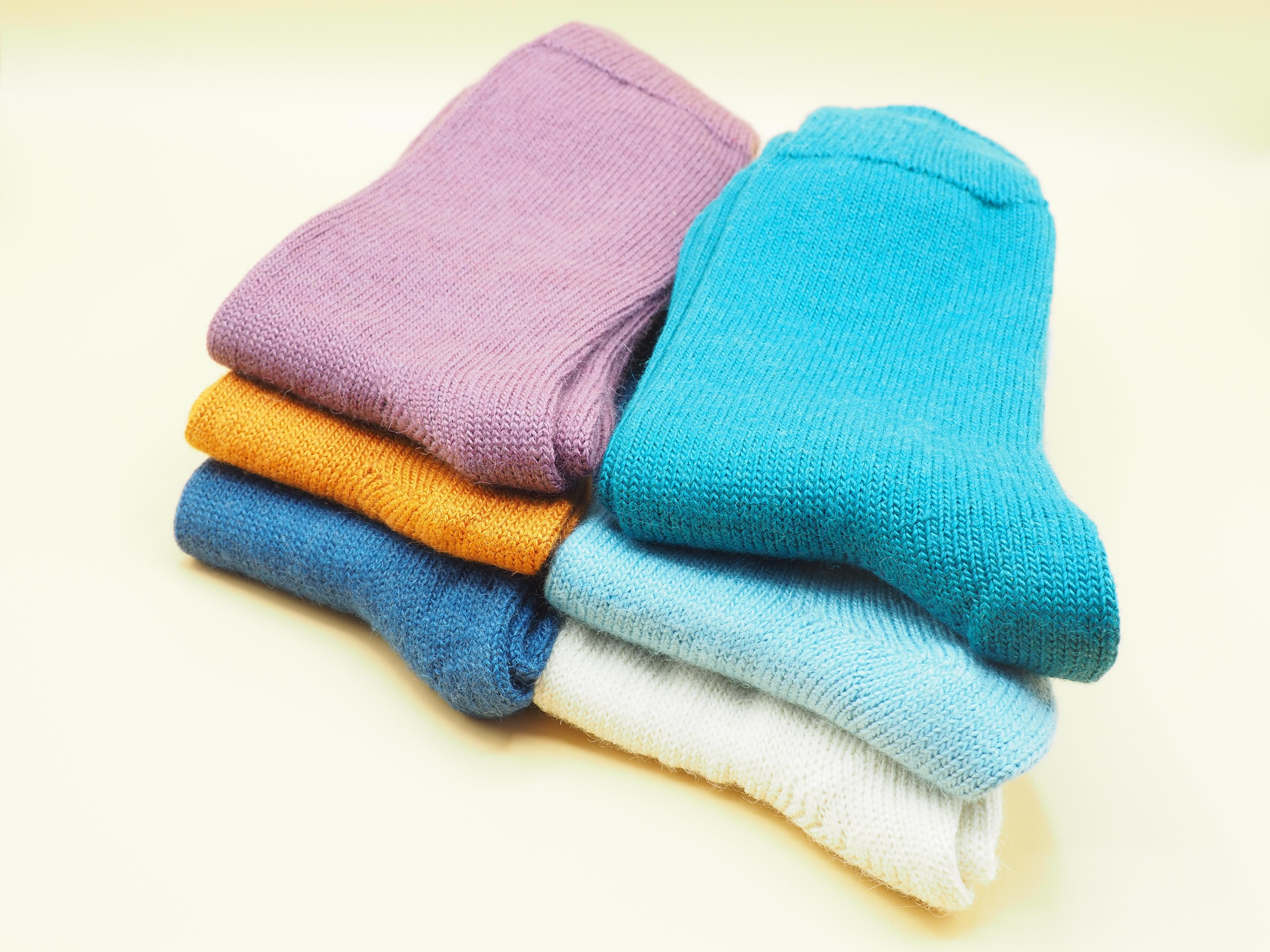 two-piles-of-wool-socks