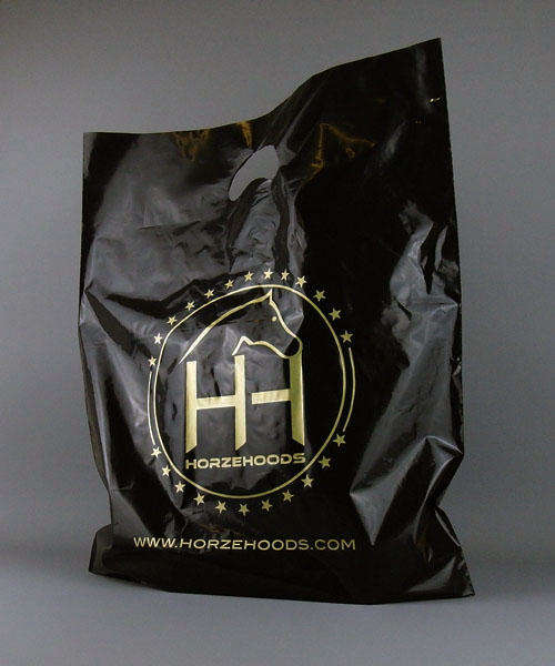 black plastic carrier bag printed in gold with handle
