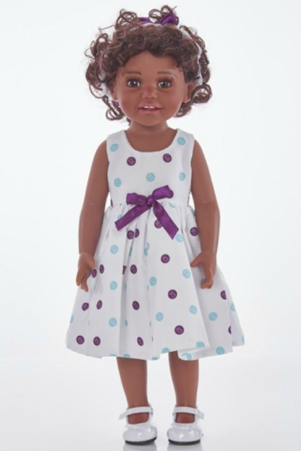tall black doll in white dress