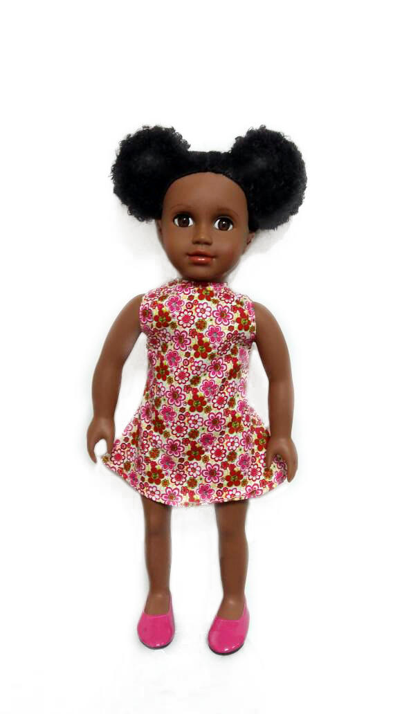 black doll in pink flower dress
