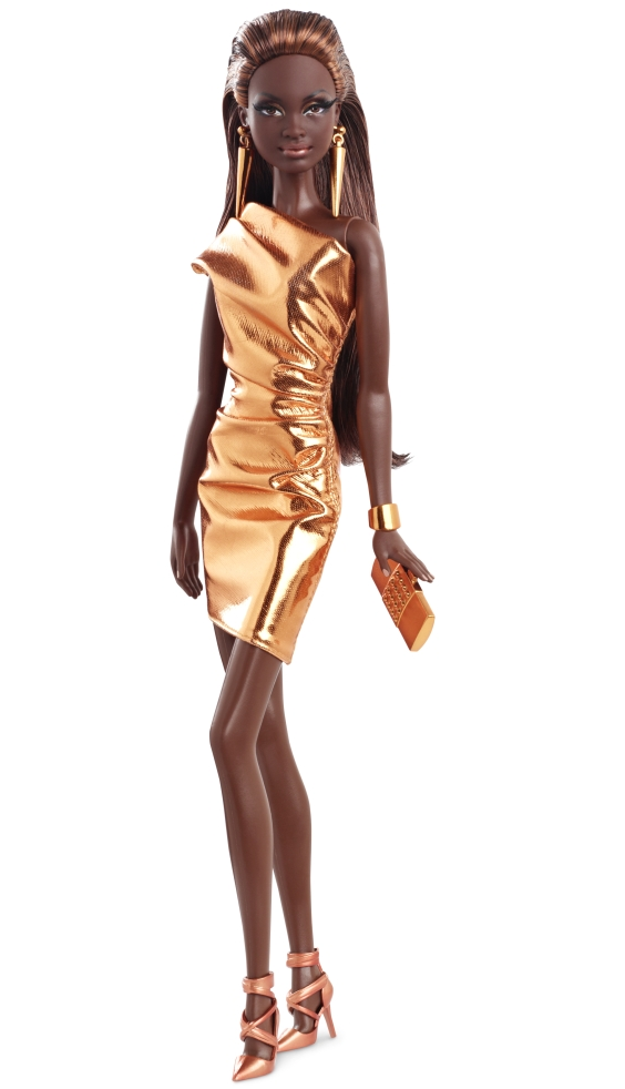 Barbie black doll in a gold shiny dress with clutch bag