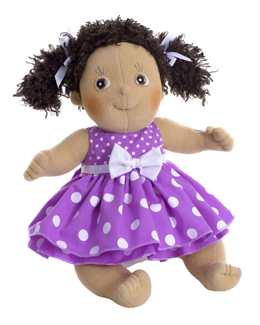 mixed race doll in purple spotty dress
