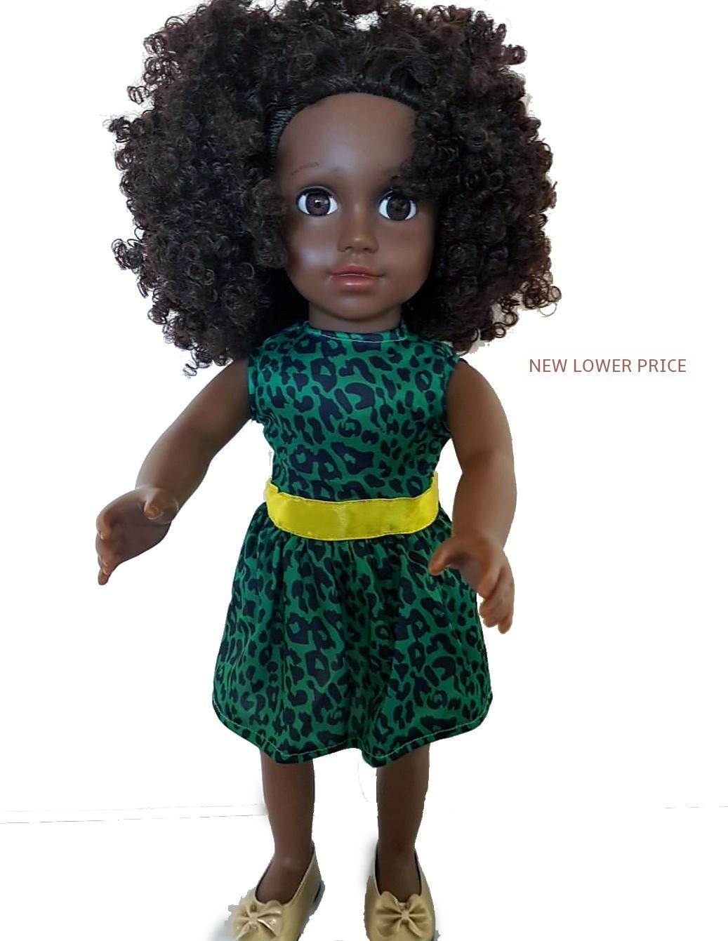 black doll in green and yellow stripe dress