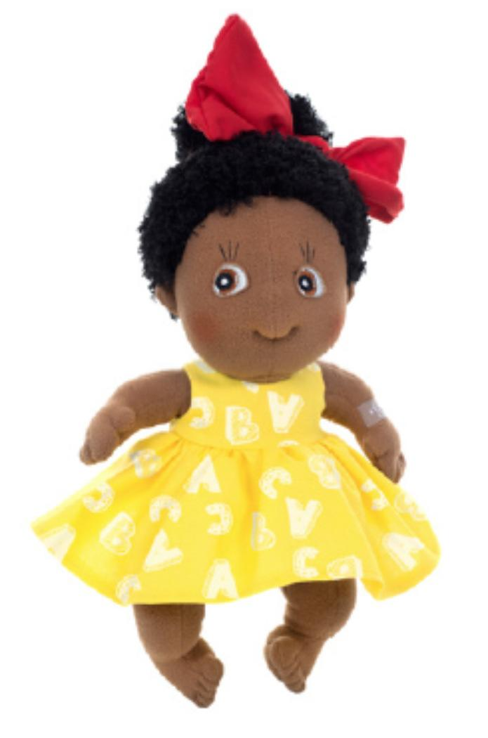 black rag doll in a yellow dress