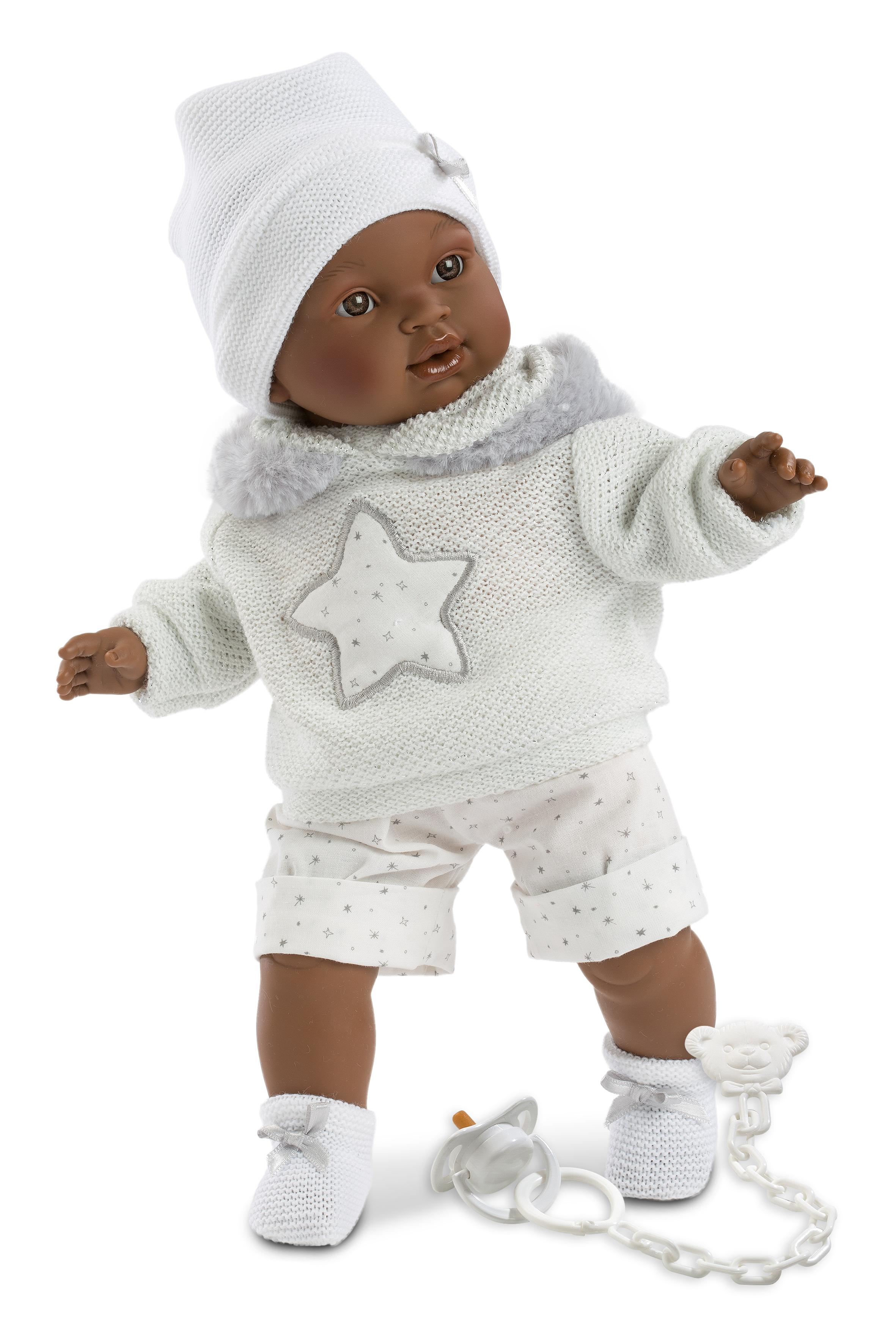 black boy doll in a white outfit