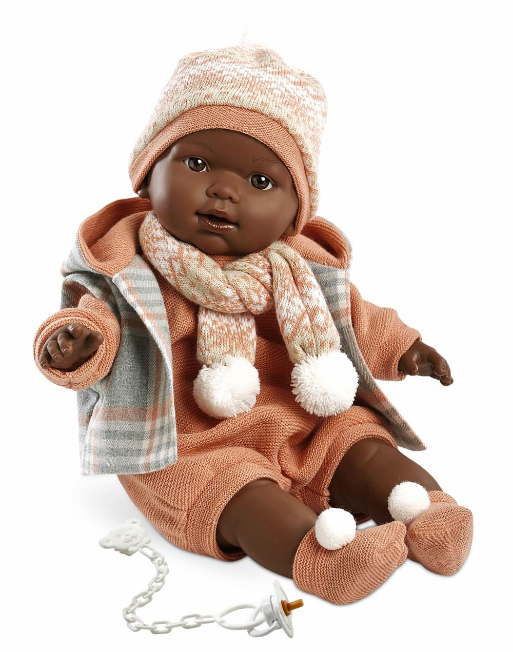 black boy doll in a peach outfit