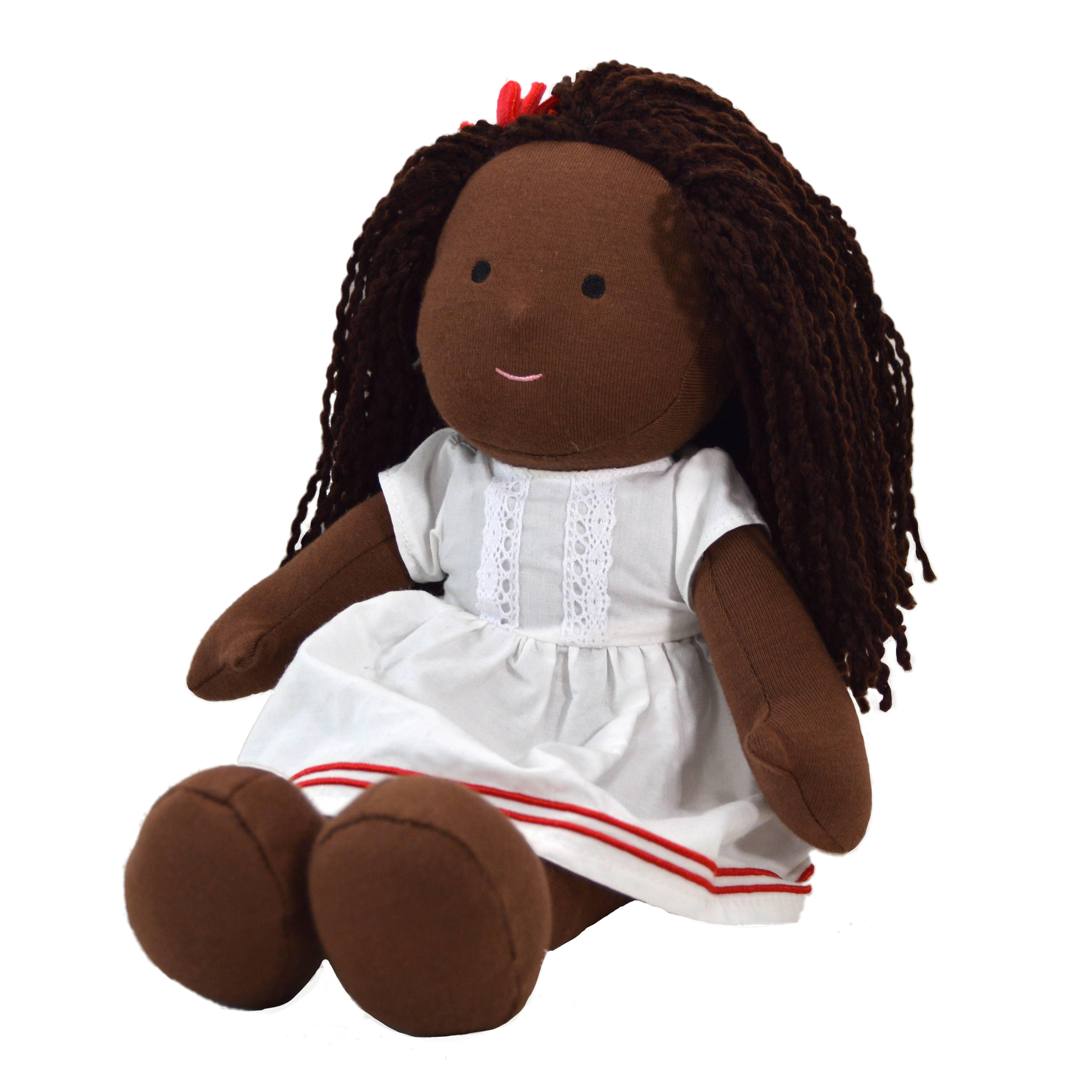 African rag doll in a white dress