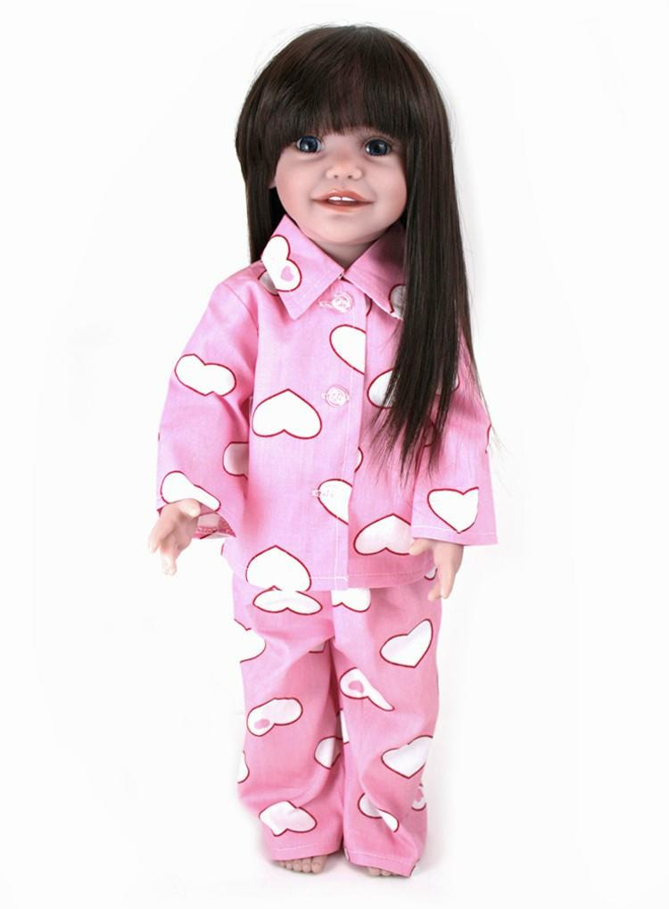 Doll in pink heart pyjamas
