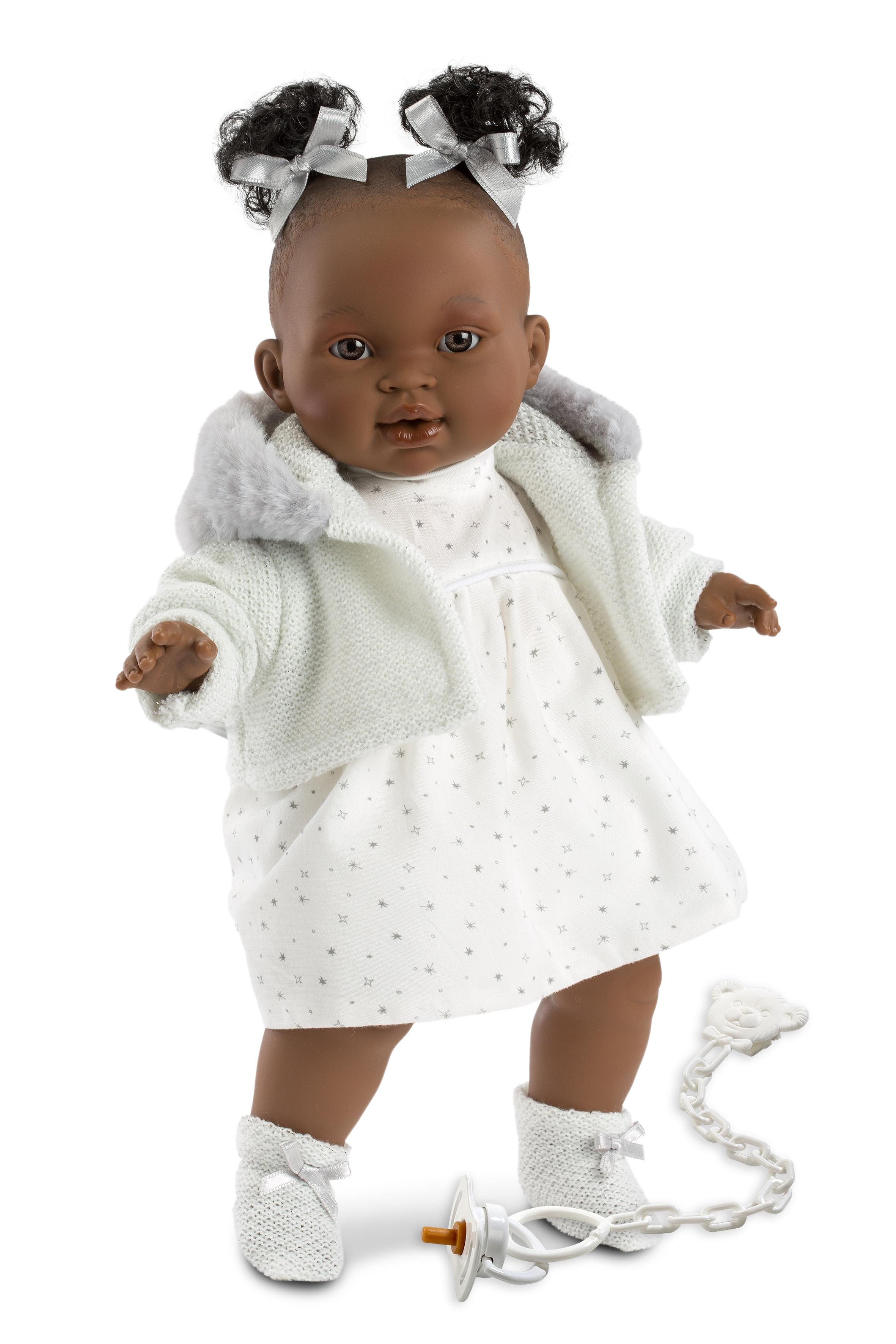 black doll in white spotty outfit