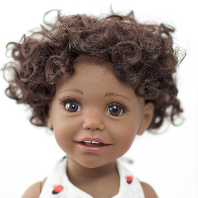 black doll with brown curly hair