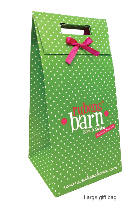 green and white spotty gift bag