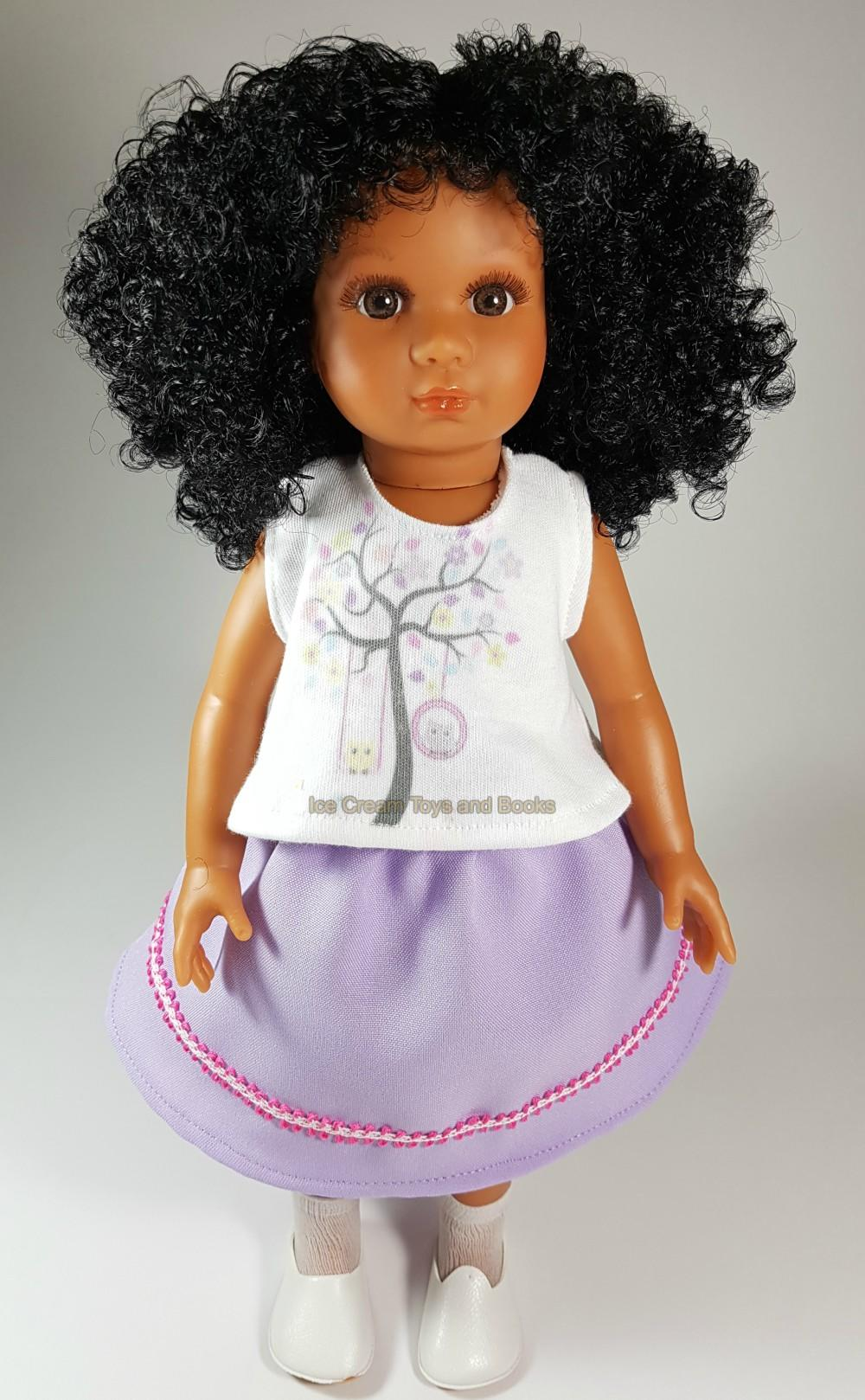 mixed race doll in a lilac skirt and white top