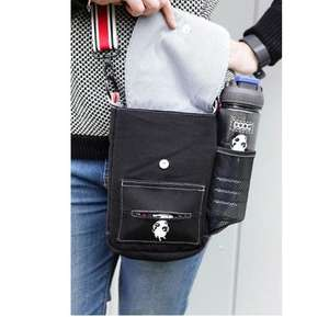DOOG Walkie Shoulder Bag in Black opened with DOOG water bottle