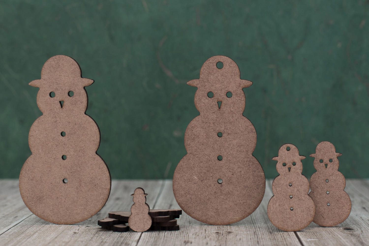 Group of laser cut snowman shapes of various sizes