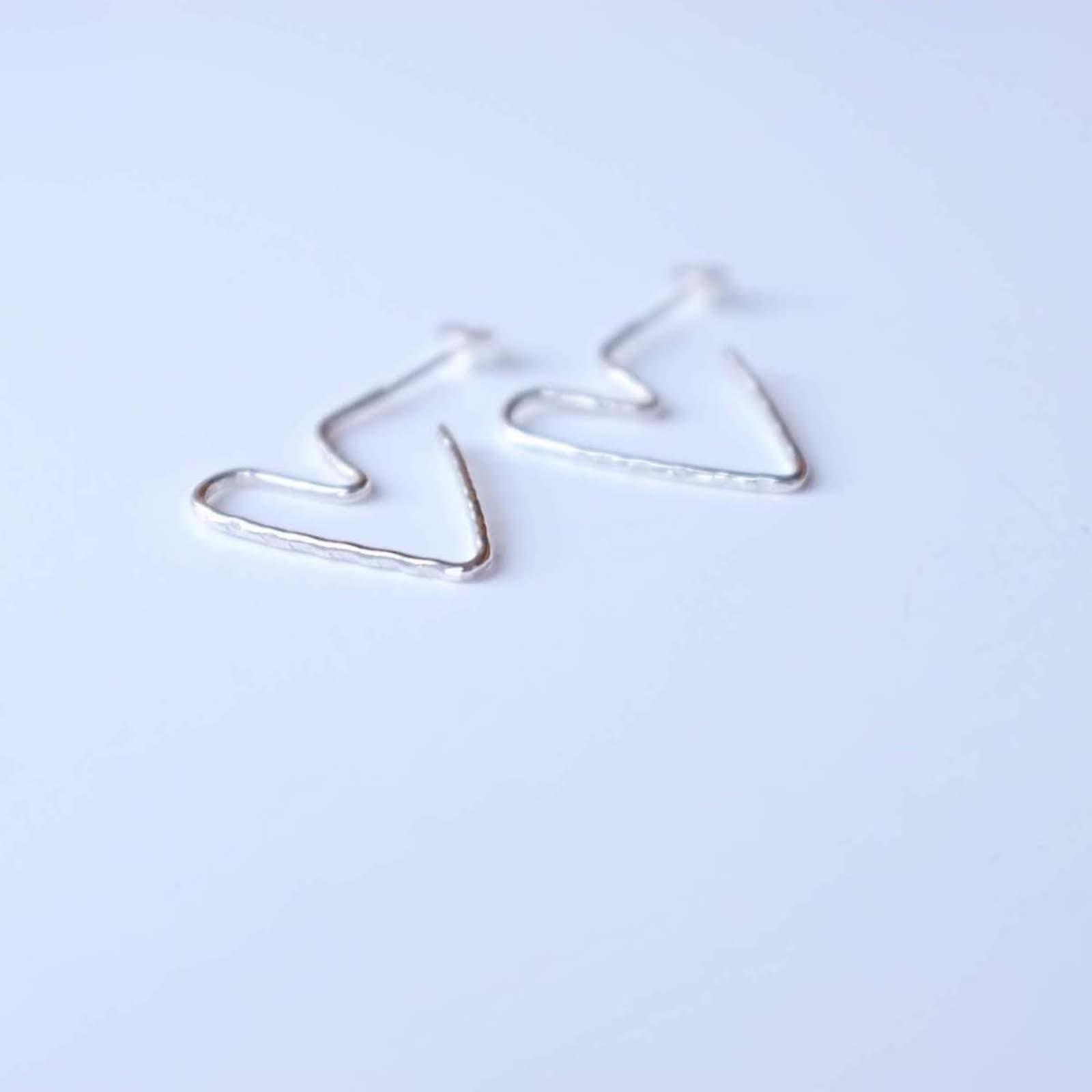 Heart Hoop Earrings On Table