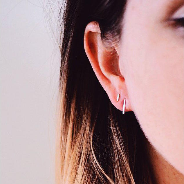 Stud Earrings Being Worn