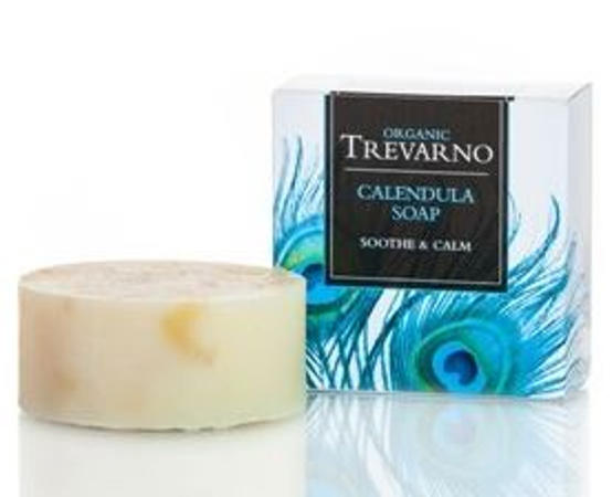 cream round bar of soap, white square box with blue feathers, black label, blue writing, trevarno organic calendula soap