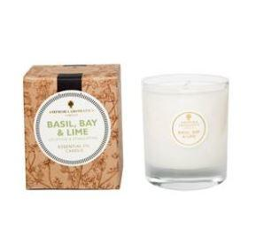 Ivory candle in clear glass pot label shows Amphora Basil & Bay
