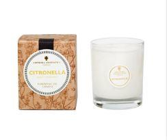 Ivory candle in clear glass pot, next to a natural brown card decorated box showing citronella candle