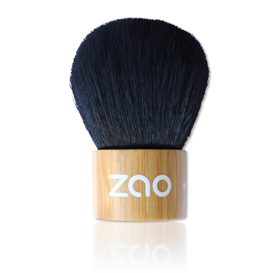 kabuki brush with light bamboo wood handle and black synthetic hair label shows Zao