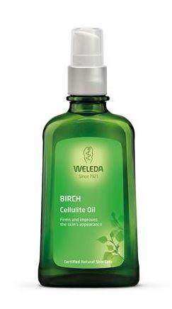 A dark green bottle with white cap. Green label shows weleda birch cellulite oil.
