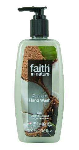 A clear plastic bottle with black pump dispenser. Label shows photo image of sliced coconuts and text of faith in nature coconut hand wash.