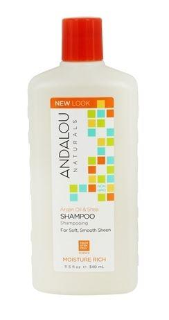 A white plastic bottle with orange flip top cap. Label shows andalou argan moisture rich shampoo