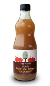 A clear bottle with green cap containing cloudy brown vinegar. A green label shows tree of life apple cider vinegar with mother.